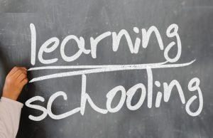 Learning schooling written on chalkboard