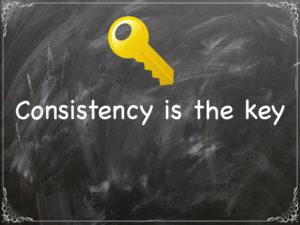 Consistency is the key written on chalkboard